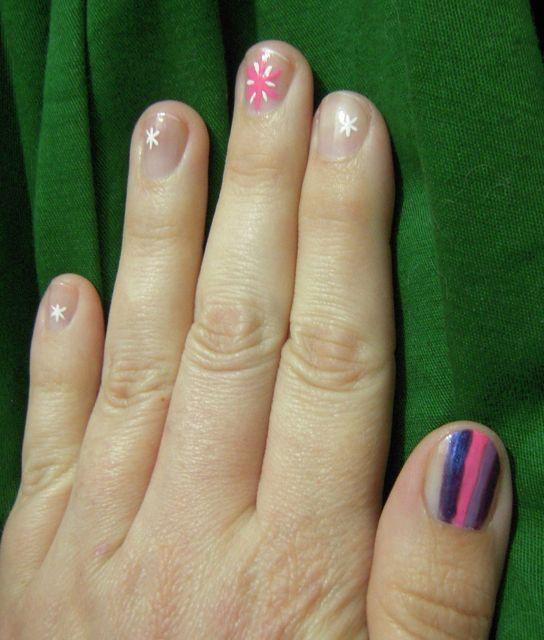 [Manelike stripes on thumb, pink star on middle finger, little white asterisks on other fingers]